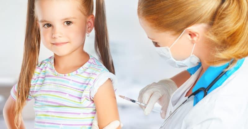 Pediatrician makes a child vaccination