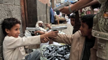 Kids in Sanaa playing with toy guns