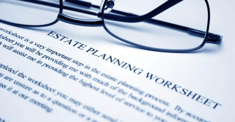 Close up of reading glasses on Estate planning worksheet