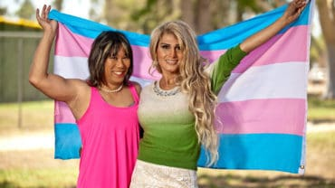 transgendered females holding pride flag