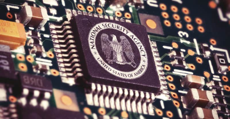 Illustration of a spying CPU inside a computer with the NSA logo on it.
