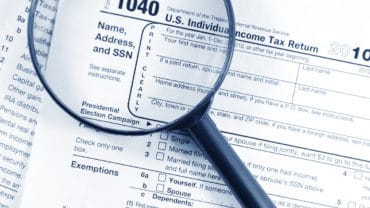 Save Download Preview Tax forms investigation concept with magnifying glass and 1040 US Income Tax Return