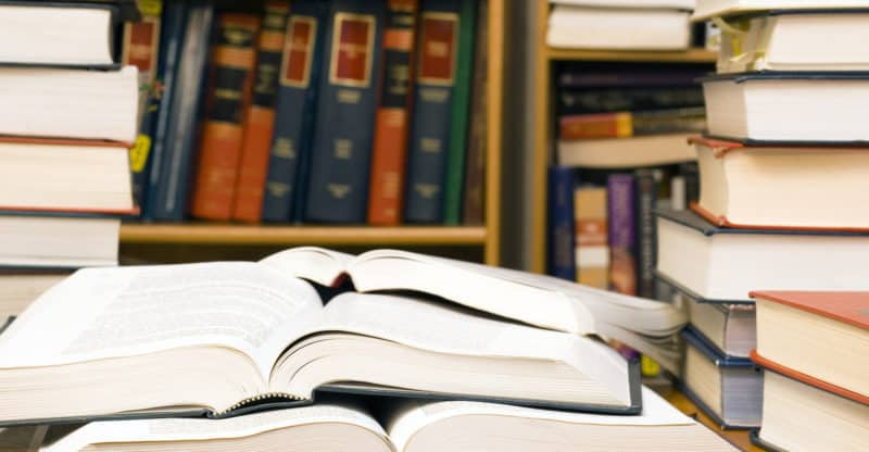 Stacks of books in a library or office for studying law