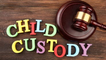 A gavel and colourful letters regarding child-custody and family