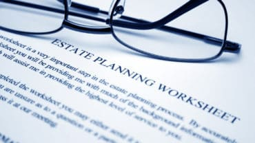 Close up of reading glasses on Estate planning worksheet