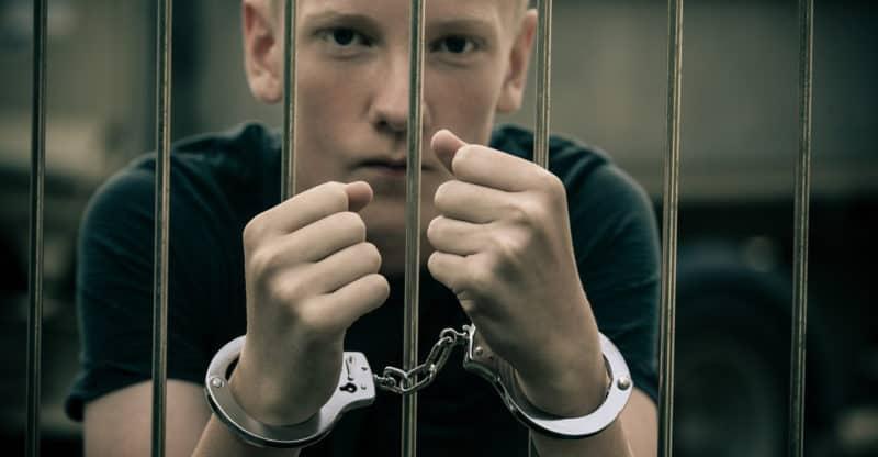 juvenile delinquent behind bars