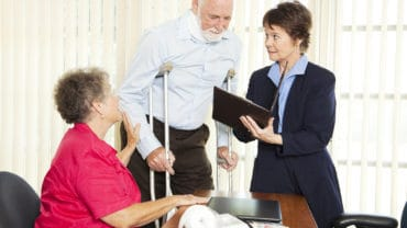Injured man and his wife meet with a personal injury lawyer