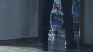 Picture of pedophile standing at the child room entry