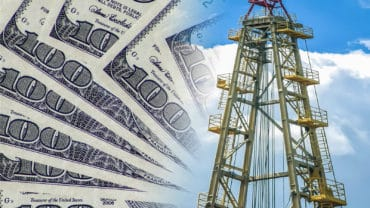 Drilling rig for mining amid money . The concept of price changes on the oil market