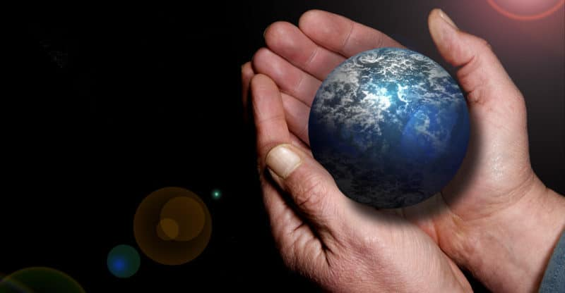 A pictorial of Earth in a pair of hands