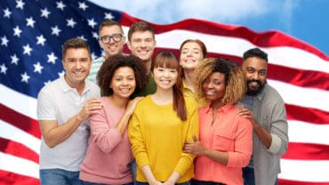 diversity, immigration, friendship and people concept - international group of happy smiling men and women over american flag background
