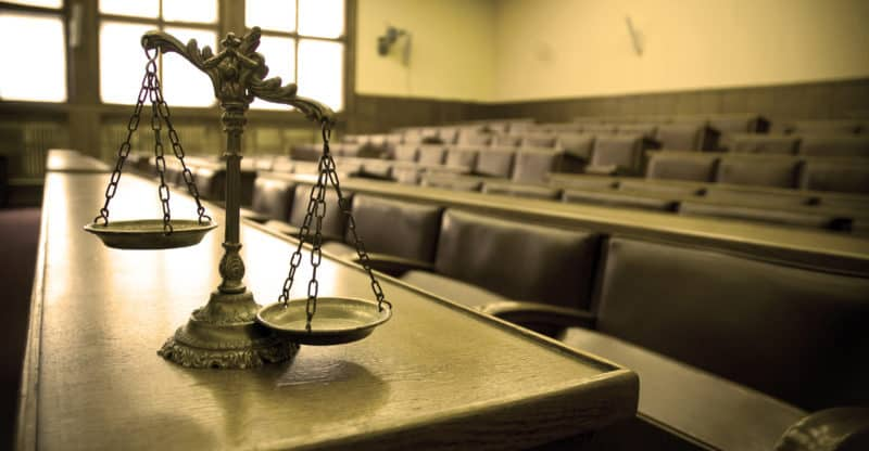 Symbol of law and justice in the empty courtroom law and justice concept ** Note: Slight graininess, best at smaller sizes