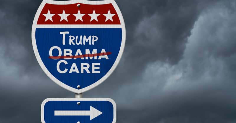 Repealing and replacing Obama Care healthcare insurance Red white and blue interstate highway road sign with words Trump Care with stormy sky background 3D Illustration