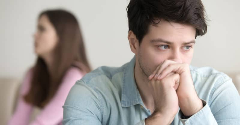 Sad young man thinking over a problem, guy frustrated after quarrelling with girlfriend, stressed and worried about financial issues, making decision and confused, bankruptcy, unpaid debt