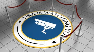Round illustration laying on a tiled floor with the text NSA is watching you.