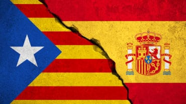 spain flag on broken brick wall and half catalan flag vote referendum for catalonia independence exit national crisis separatism risk concept
