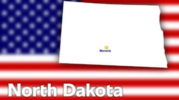 North Dakota state contour with Capital City against blurred USA flag