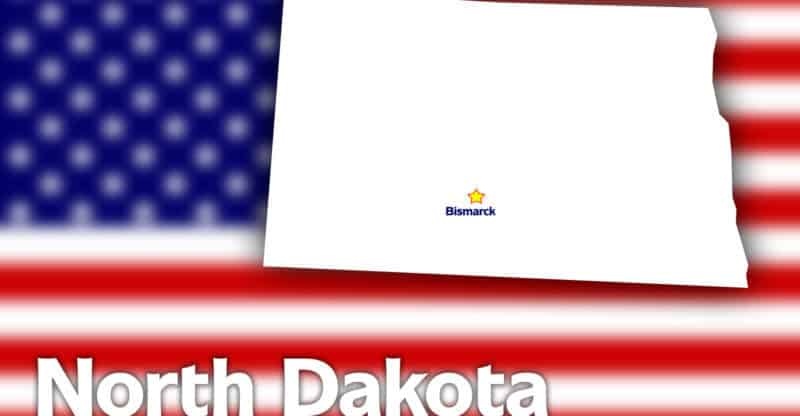 North Dakota state contour with Capital City against blurred USA flag