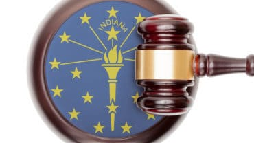 Wooden judge gavel with USA state flag on sound block - Indiana
