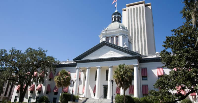 The old Florida State Capital building now a museum stands in front of the new capital offices in Tallahassee Florida.