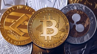 Bitcoin, litecoin and ripple coins currency finance money on gra